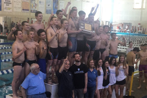 Shawnee Mission East's boys swim team celebrated the school's third consecutive state title in Topeka Saturday. Photo via SME Athletics on Twitter.