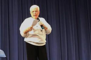 Jane Elliott on stage in the Shawnee Mission East auditorium Thursday night. Photo via Elliott on Facebook.