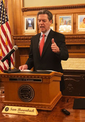 Brownback after vetoing the tax bill Wednesday morning. Photo via Brownback's Twitter account.