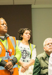 First Student employees wore their safety vests as they packed the school board chambers ahead of Monday's vote.