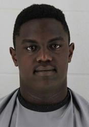 Kamau Kimaru's booking photo from the Johnson County's Sheriff's Department.