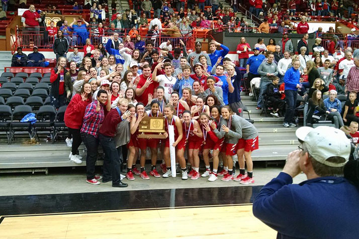 The Bishop Miege girls basketball team celebrated its 2017 title in Salina. Photo via Twitter.