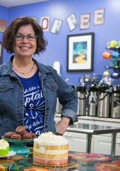 Kathy Fullerton does some of the production of The Beachery's baked goods in the kitchen at Twisted Sisters on Johnson Drive.