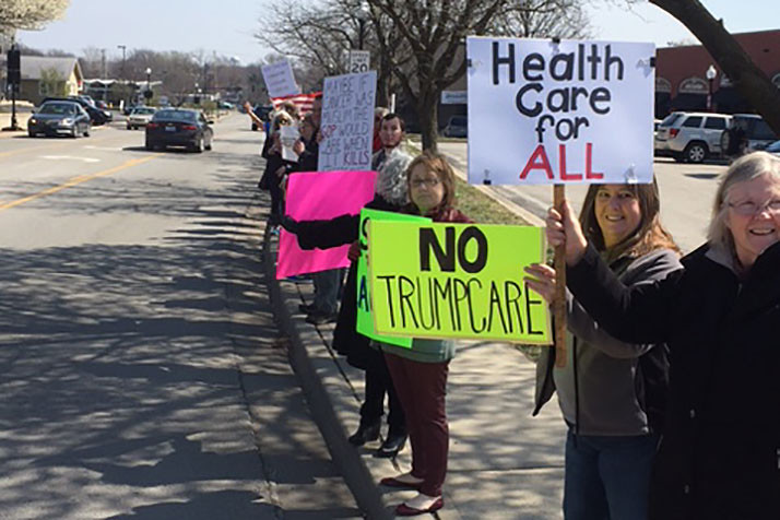 Protestors lined 79th Street outside Rep. Kevin Yoder's office to voice disapproval of the GOP healthcare plan.