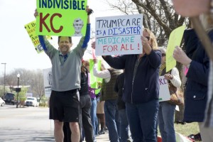 Advocates lined the street Thursday in front of Kevin Yoder's Overland Park office.