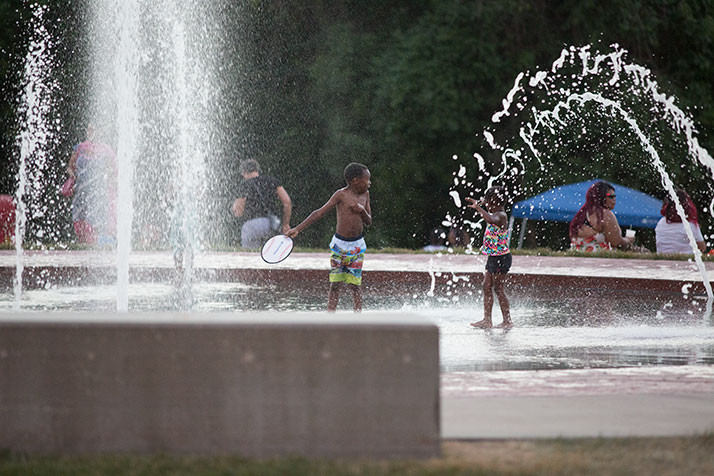 Kids at play in a Corporate Woods fountain at the 2016 SoJo Summerfest.
