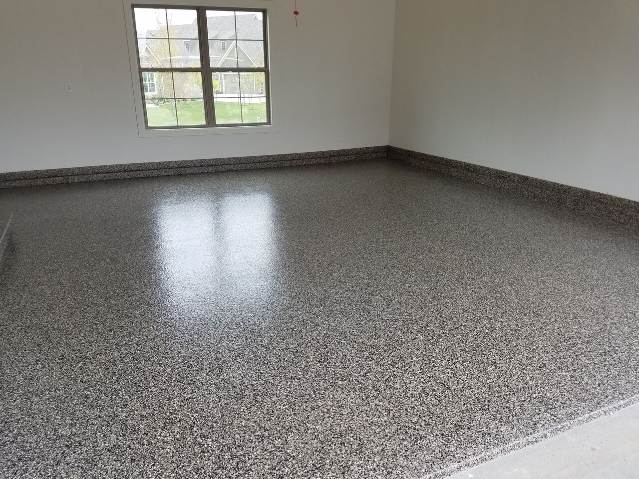 Top 5 ways epoxy can positively impact your home 39 s for How do you clean concrete garage floor