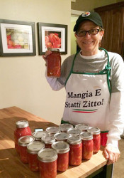 Ann Scida canning tomatoes. Photo via Facebook.
