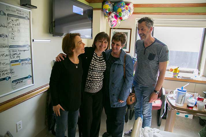 Anne-Sophie Rocuet (from left), Sandy Burgers, Laure Losey and Christian Burgers in Lottie's hospital room.