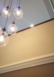 A stylish light fixture hang in the loft entry after the renovation.