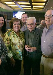 From left, Nancy Henry of Spangler's, Debbie Richmond of Bruce Smith Drugs, Diane Harsh and David Harsh of Tiffany Town, Bill Spangler of Spangler's, and Bob Harsh of Tiffany Town. The Village merchants held a reception at C. Frog's Thursday honoring the longtime Village Shops businesses, which all announced their closure in recent months.