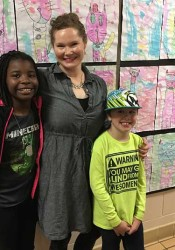 Rushton art teacher Alexis Burdick with two of her students at the Sylvester Powell art show.