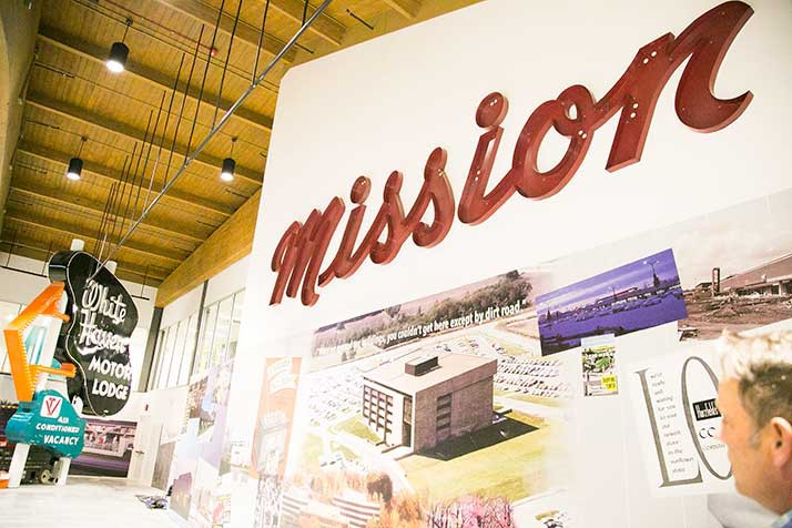 A sign from the original Mission Shopping Center hangs prominently on the Johnson County Museum walls.