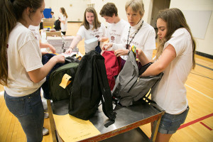 Indian Hills students assembled backpacks full of school supplies for SMSD families in need as part of the school's day of service in May. Increased poverty levels in Shawnee Mission have seen demand for such assistance rise sharply in recent years.