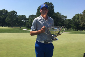 Andy Spencer with the 2017 Watson Challenge trophy. Photo via SM East Golf on Twitter.
