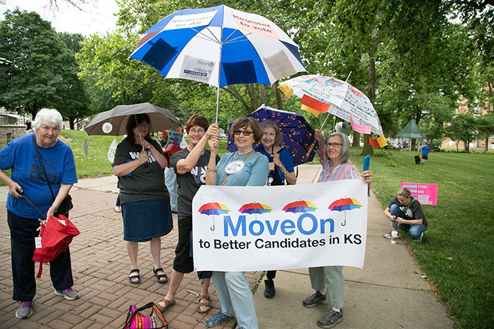 "The MoveOn ""Join Us Under the Umbrella"" team."