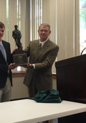 Thomas Luger receiving the Kenneth Smith Award at SM East Wednesday. Photo via Twitter.