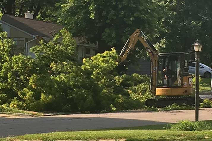 City crews worked to clear the streets of fallen limbs in northern Overland Park Sunday.