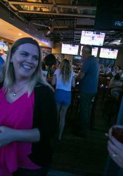 Heather Ousley celebrated with supporters after the early voting results were posted Tuesday evening.