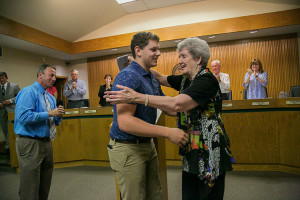 Mission city councilwoman Suzie Gibbs gives SM North student council president Cameron Peck a hug after he presented the city with a check for its Holiday Adoption Program.