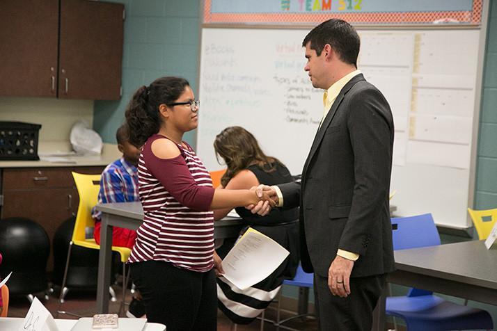 ApacheIS principal Britt Pumphery shakes the hand of a job applicant.