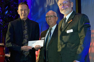 Bob Lindeblad of Faith Lutheran presents a check to Metro Lutheran Ministries. Photo courtesy MLM.
