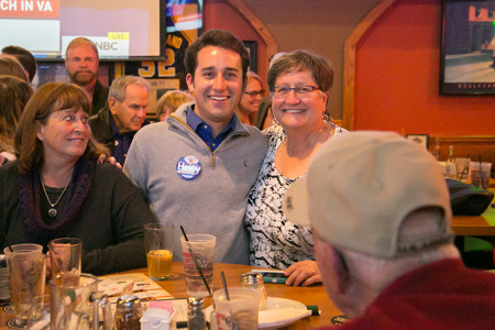 Logan Heley and his mother Kay Heley watched election returns together in downtown Overland Park Tuesday. Both Kay, who ran for WaterOne board, and Logan won their races.