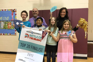 Merriam Park instructional coach Dustin Springer and principal Cho Druen celebrate with students after learning they were finalists in this year's Battle of the Brains competition. Photo via Merriam Park Elementary on Twitter.