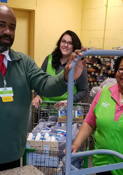 Walmart employees helped put the meals together and donated hundreds of dollars worth of food.