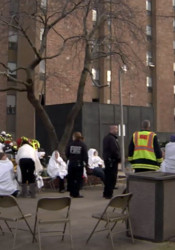 Fire crews provided blankets for residents of the Overland Towers Apartment displaced during Monday's fire. Video still courtesy Overland Park Fire Department.