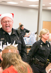 Officers helped the students decorate cookies for their families' holiday celebrations.