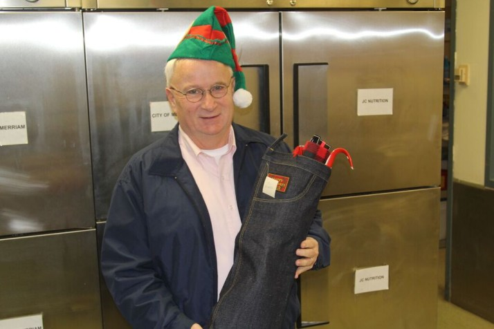 Couty Commissioner Jim Allen was among the crew that delivered stockings to Meals on Wheels clients Wednesday. Photo courtesy Johnson County Government.