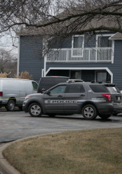 The Harris's Overland Park apartment was blocked off as a crime scene Tuesday.