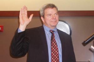 Matt Zimmerman taking the oath of office Monday. Photo by Jerry LaMartina.