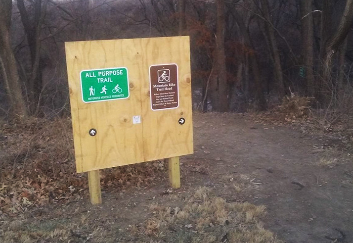 The current signage at the head of the new Nall Park trail.