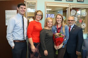 District leaders congratulated Ali Mackenzie after she learned she'd won the Kansas Horizon Award.