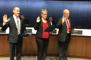 Corey Hunt, Mandy Stuke and Bill Nicks taking the oath of office.