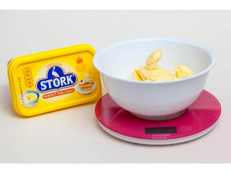 Before you start pre heat your oven to 150 degrees (fan). Measure out 210g stork for cakes (not stork for pastry!). You can use other margarine. You can also use butter but this will make your cakes dome a little more.