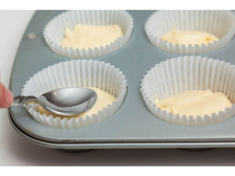 26. Each case needs to be filled to just under half way up. Using the Ice Cream Scoop for Flat Topped Cupcakes should achieve this. You can test the height using a teaspoon by pushing down gently in the middle.