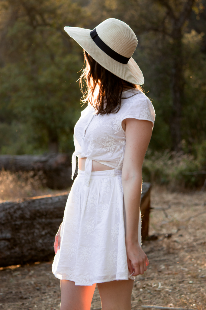 White tie-front sundress with a wide brimmed hat. So cute for summer!