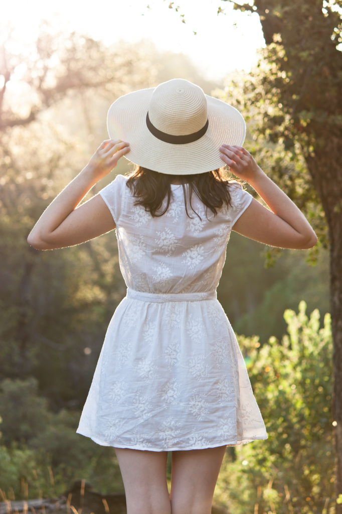 White summer sun dress with a wide brim hat