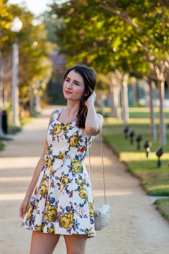 Floral bow dress with a cute quilted vegan bag