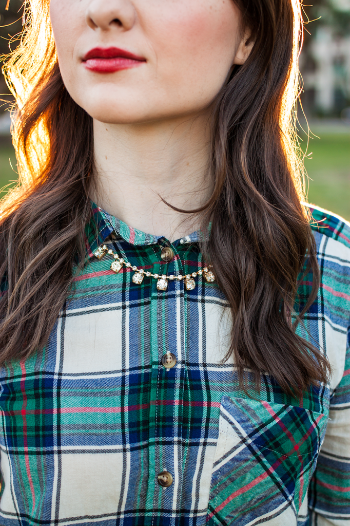 Plaid shirt with statement necklace and red lipstick