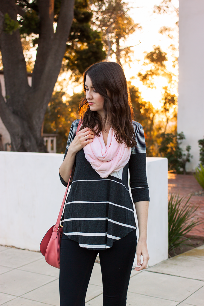 Striped top with a pink scarf