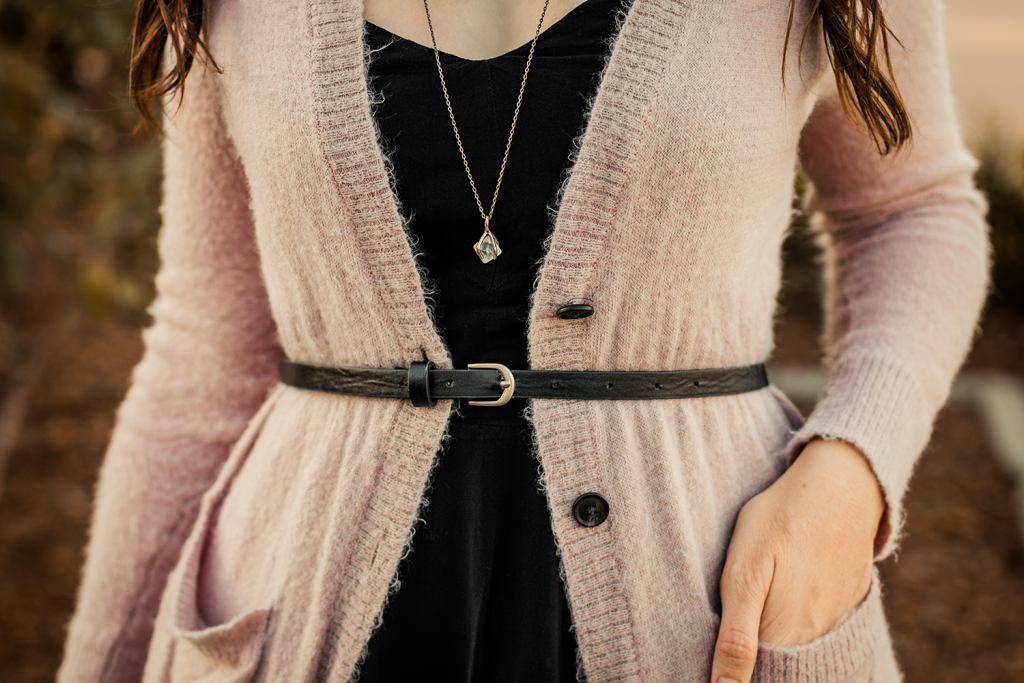 Dusty rose cardigan belted over a black skater dress