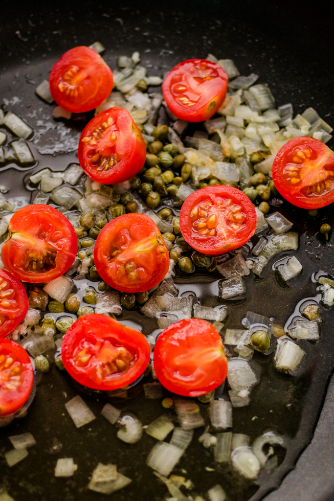 Shallots, capers, and cherry tomatoes in white wine sauce