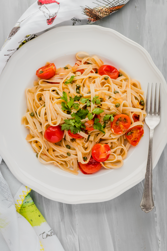 Gluten-Free Fettuccine in Vegan White Wine Sauce with Capers, Cherry Tomatoes, and Shallots