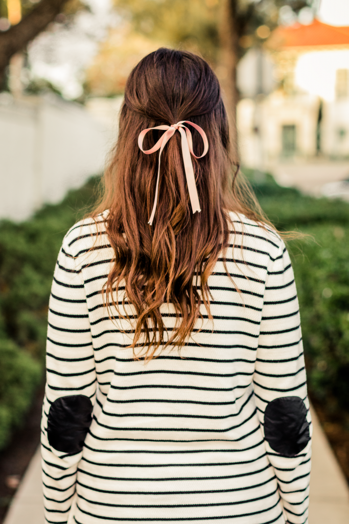 Striped elbow patch sweater and bow in hair