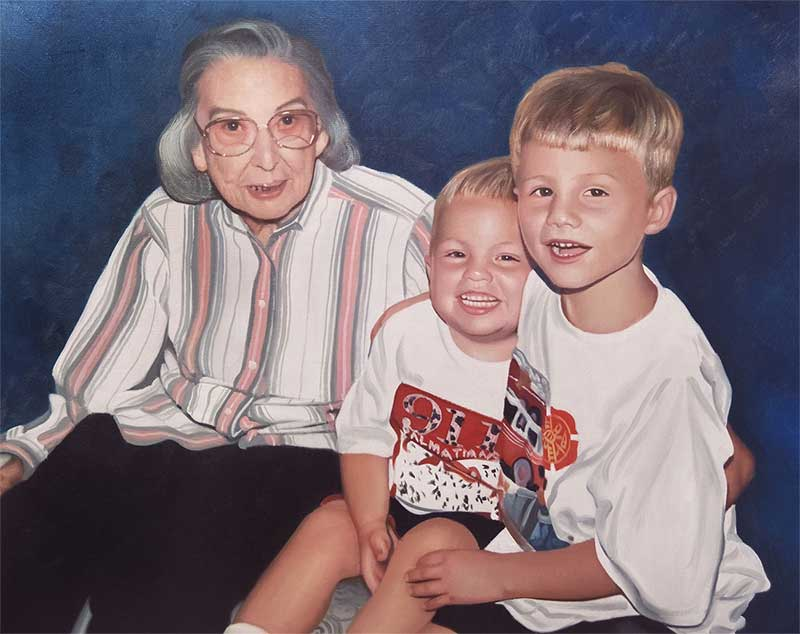 sweet family portrait of grandmother and grand kids together