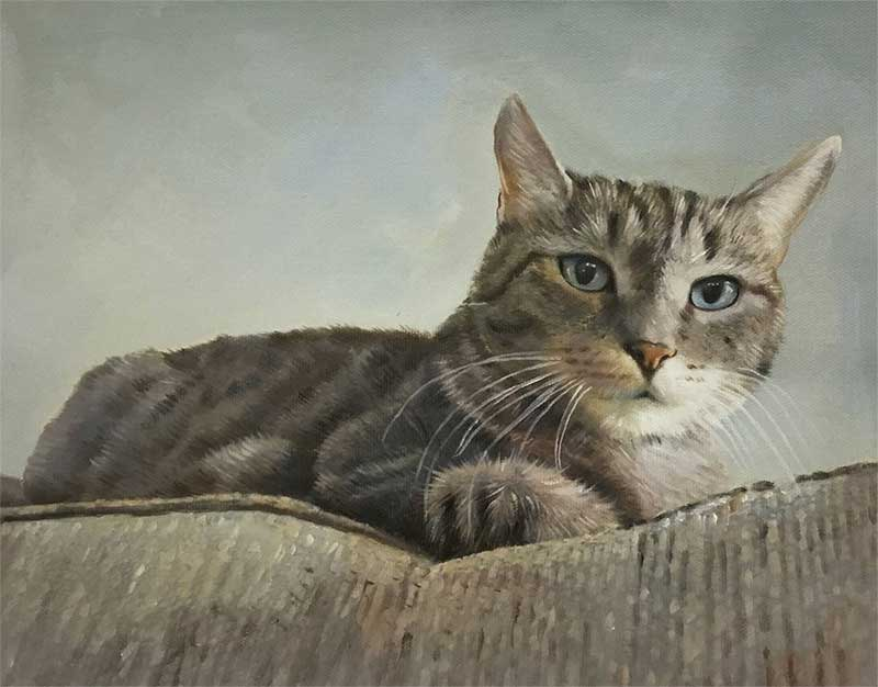 an oil painting of a cat resting on a couch